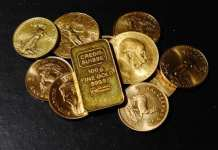 美元及美股走强 黄金期货周二降至两周新低