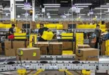 实访亚马逊仓库:在机器人面前,员工玩起了打地鼠游戏